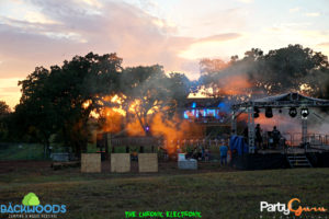 sunset at Treehouse stage at Backwoods Music Festival